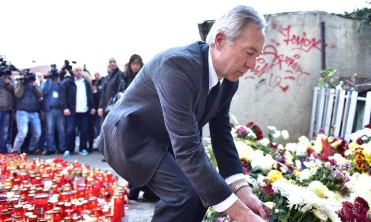 Ambassador Hans Klemm and his wife, Mari, lit candles and laid flowers in memory of those who lost their lives in the night club fire in Bucharest, Romania. November 2, 2015 (Lucian Crusoveanu / Public Diplomacy Office)